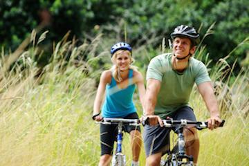 couple riding bikes | broomfield co dentist