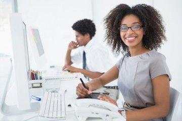 Woman in office smiling | Dentist Broomfield CO
