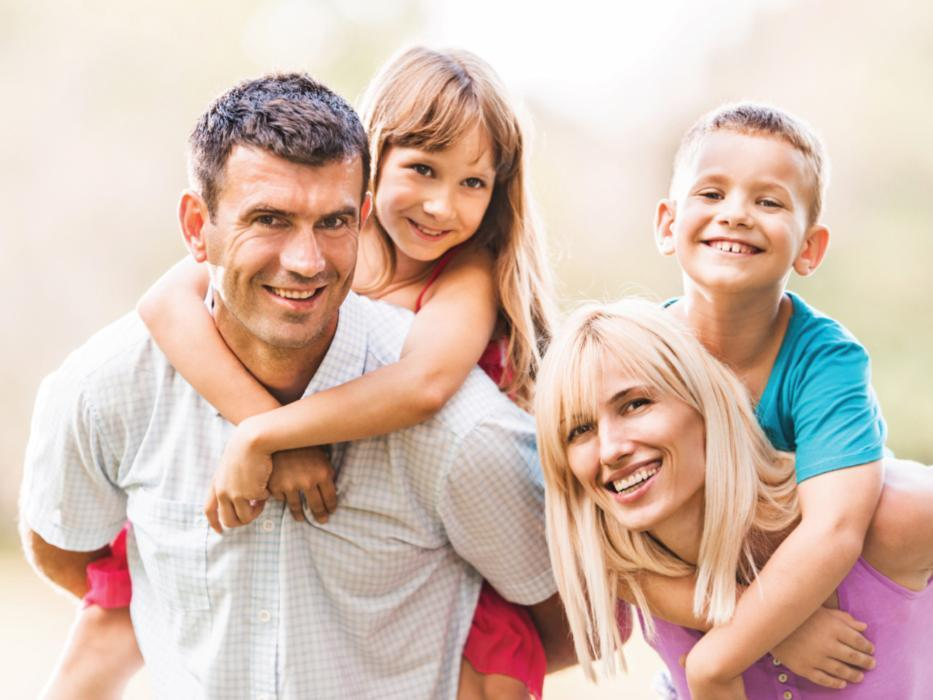 Smiling family of four | dentist broomfield CO