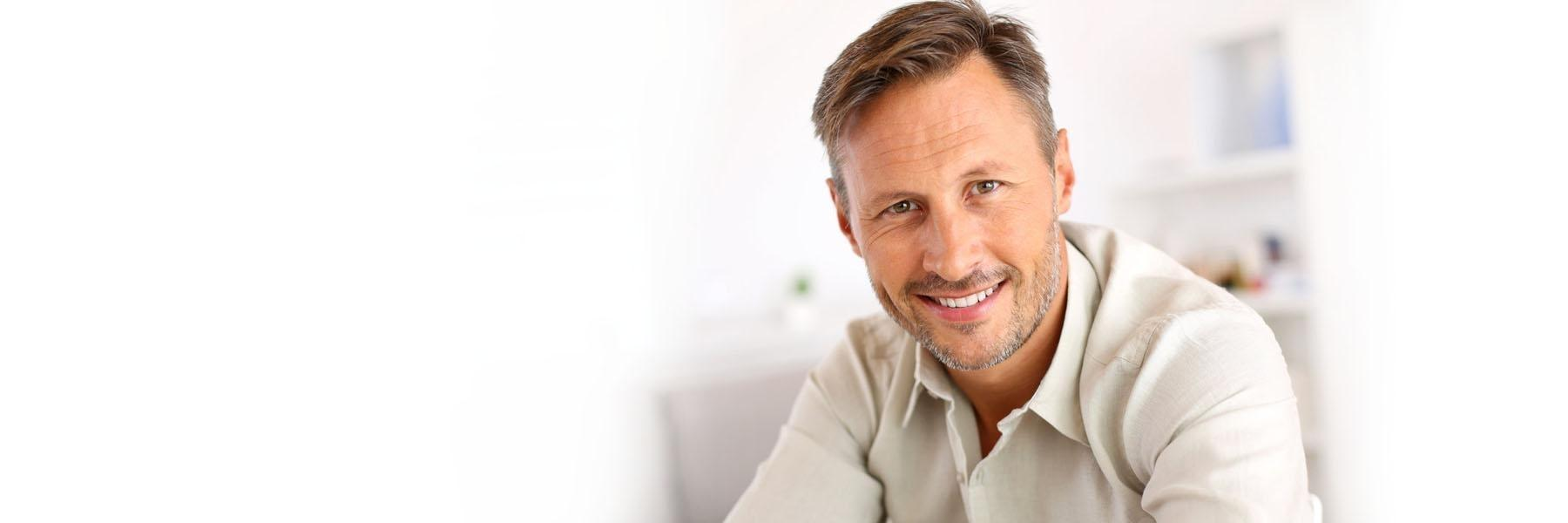 man smiling | dentist in broomfield co