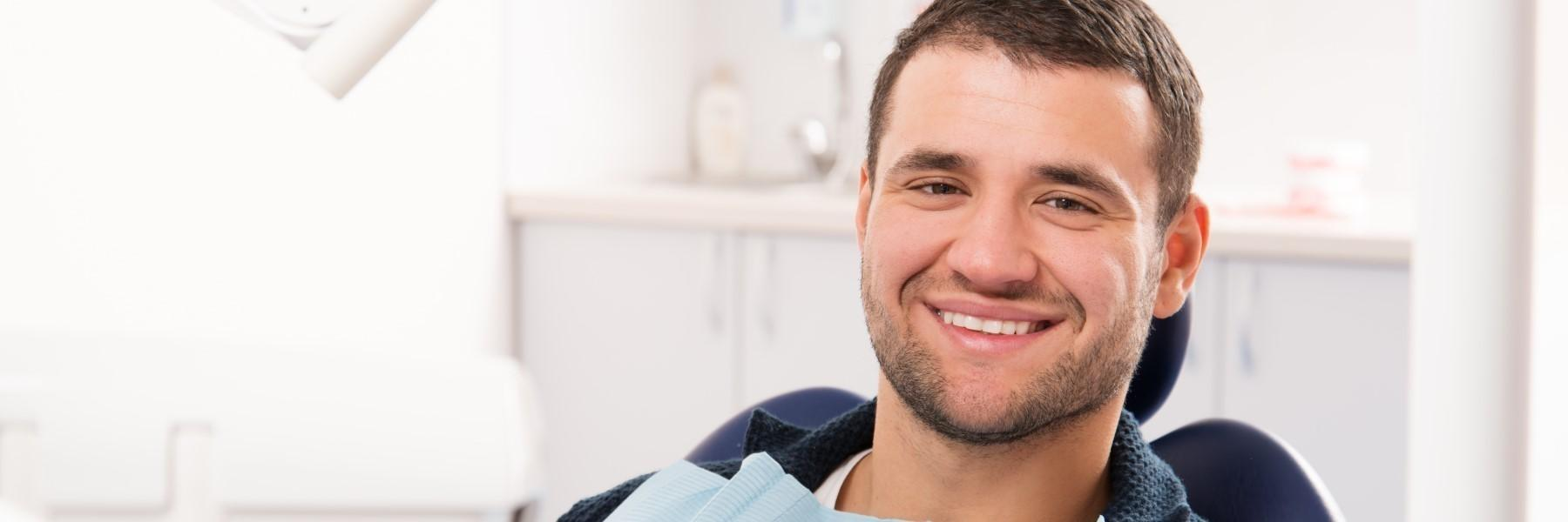 man sitting in dental chair | broomfield co dentist